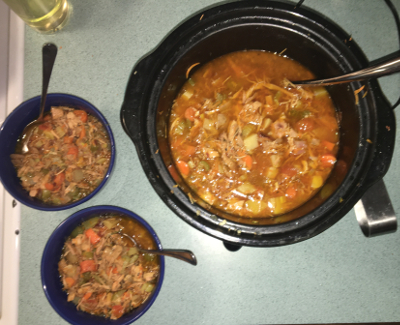 Serving Dinner - two bowls next to crock pot