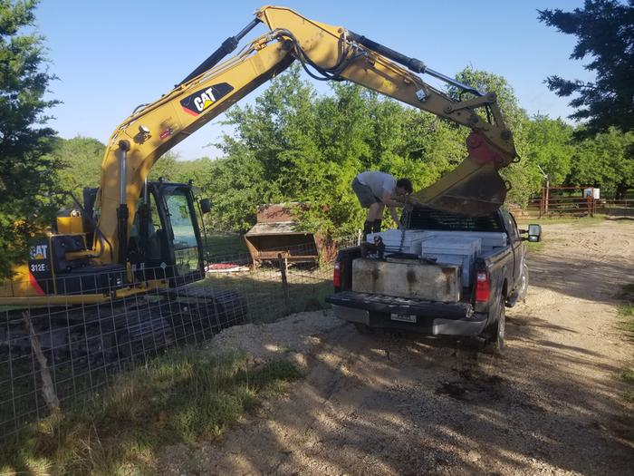 excavator for pond and swale building