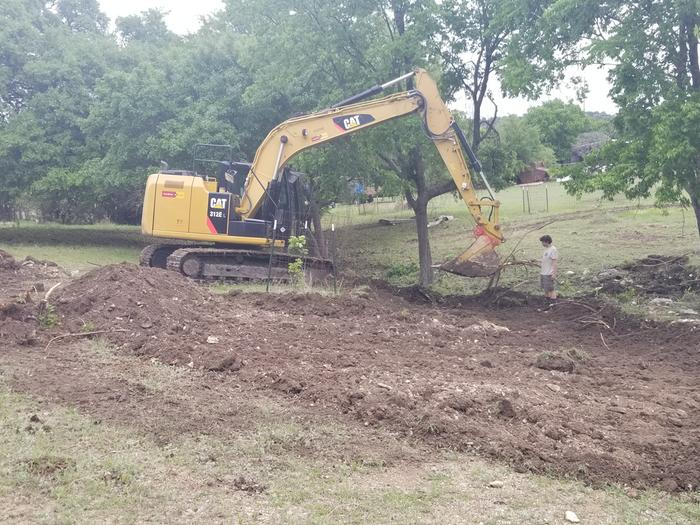 removing top soil for pond build