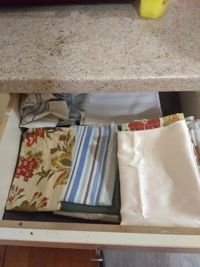 Kitchen drawer where we keep clean, folded napkins.