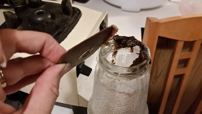 Scraping it into oil jar