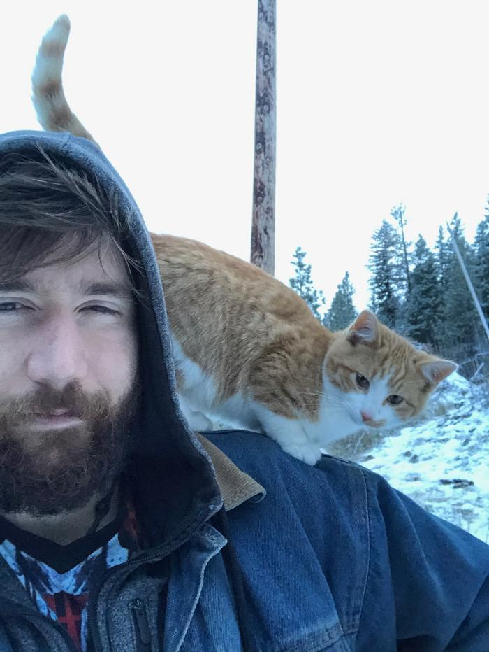 josiah with orange cat on his shoulder