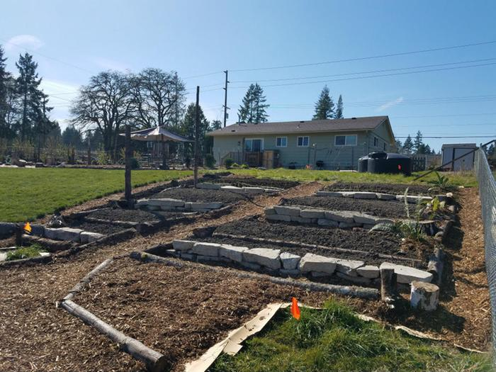 Brand new terrace garden for squash, melons, corn, carrots, onions and mixed greens plus flowers and some native plants.