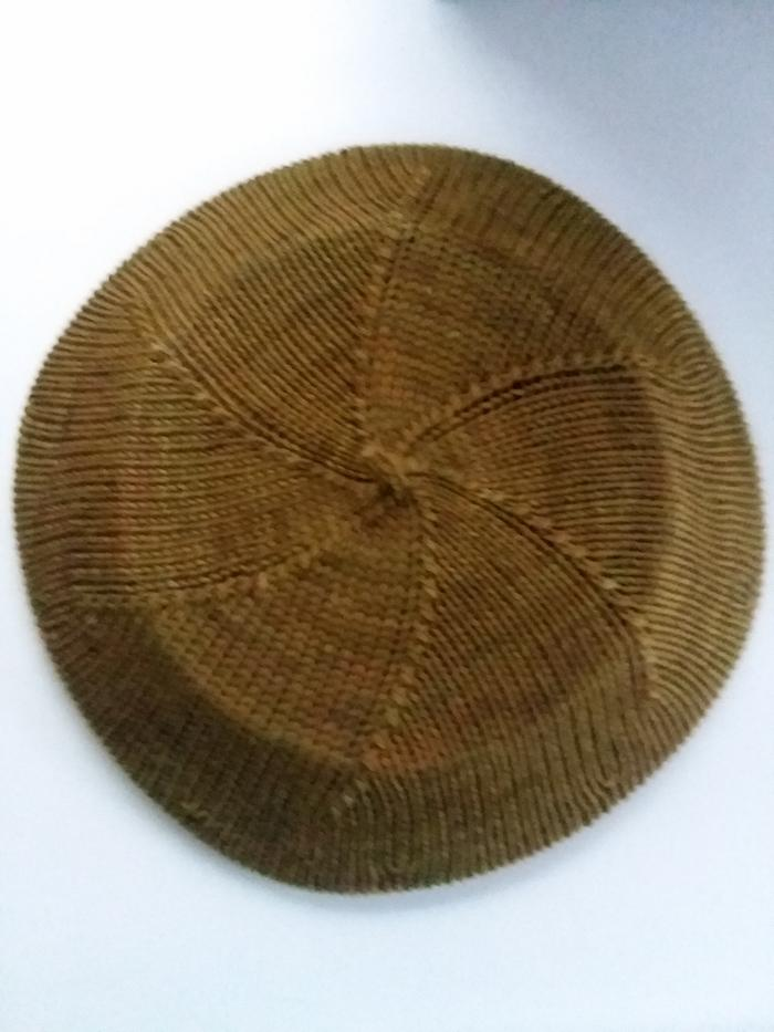 Hat blocking over a dinner plate.