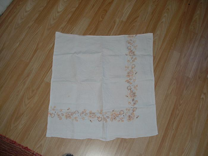 "Flat ""muslin"" nappy, made from a tablecloth"