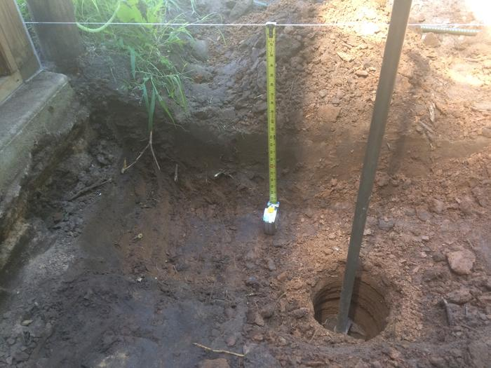 Example of where trench meets post hole in clay subsoil. This is the low point of the site.