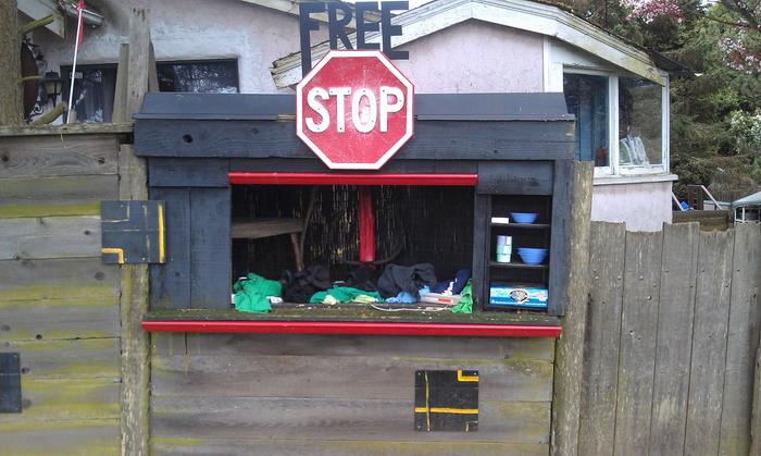 The free stop, is built into a residential fence and maintained by that family