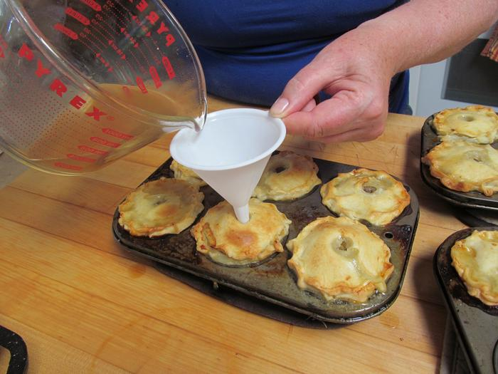 filling the pork pies - we cheated and used muffin tins to shape the pies