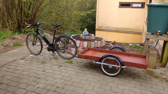 modified child carrier trailer with wooden bed