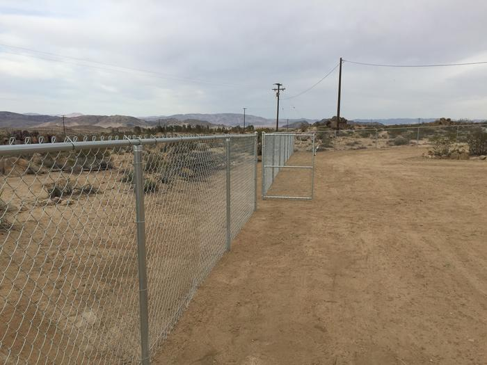 Walk-in gate in chain-link fence in the desert