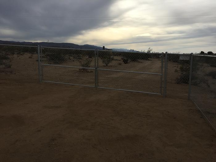 Drive-in gate in chain-link fence in the desert