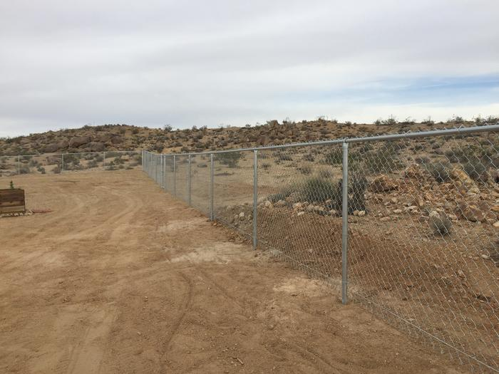 Chain-link fence in the desert
