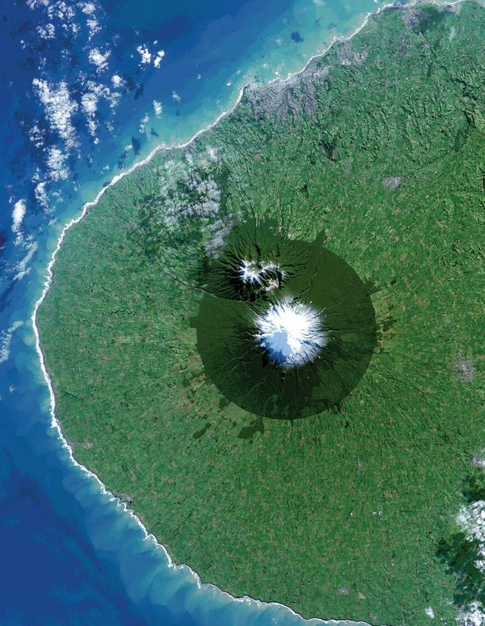 New Zealand's Mt. Taranaki, Egmont National Park surrounded by pasture, WikiMedia.org