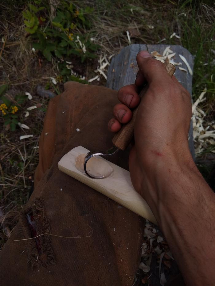 shaping wooden spoon